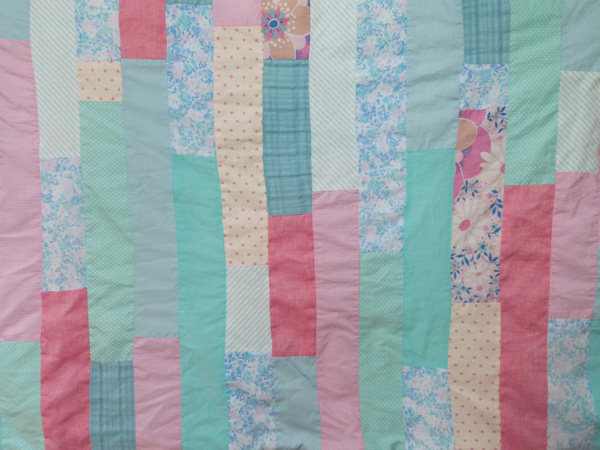 blue and pink quilt